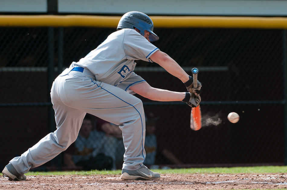 Howie Stevens' bunted ball leaves a cloud of dust  against Stroudsburg.
