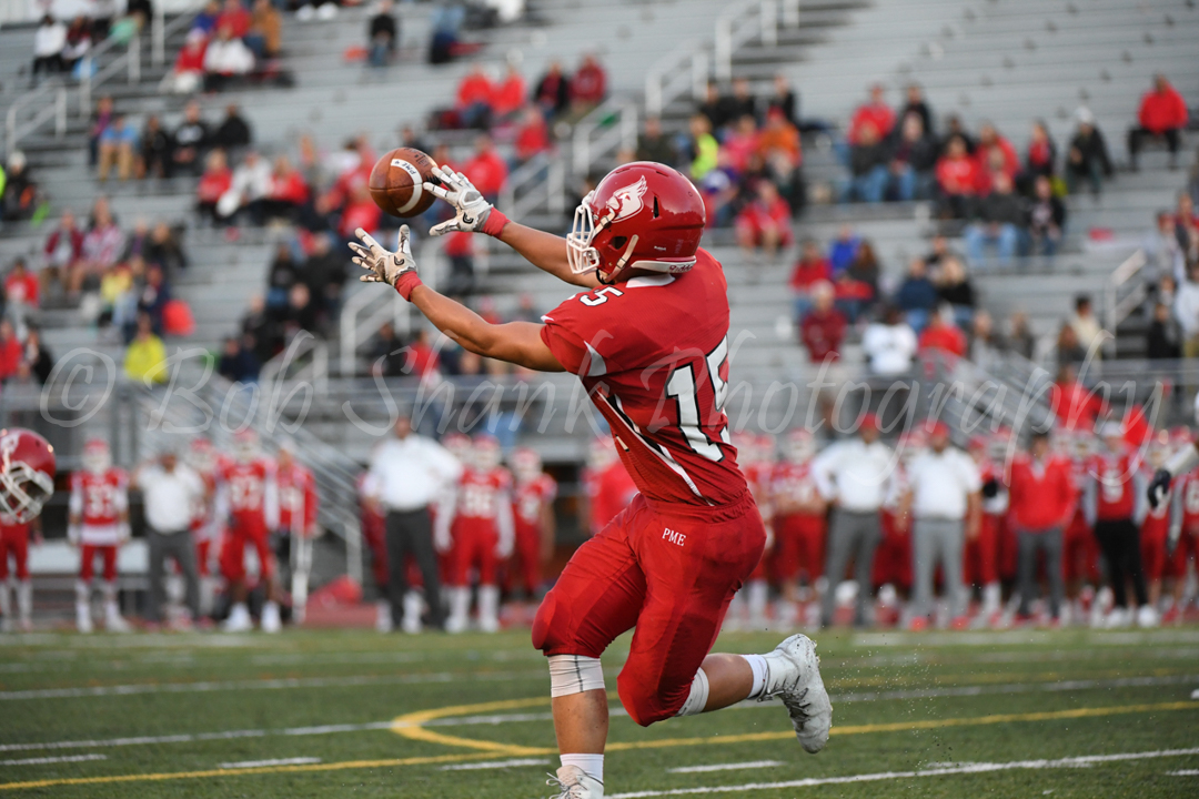 Drew Altemose (15) catches a touchdown in the first half for Pocono Mountain East against Dieruff on Friday night in Swiftwater.