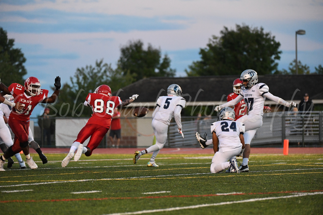 Triston Hillman (88) blocks an extra point in the first half for Pocono Mountain East against Dieruff on Friday night in Swiftwater.