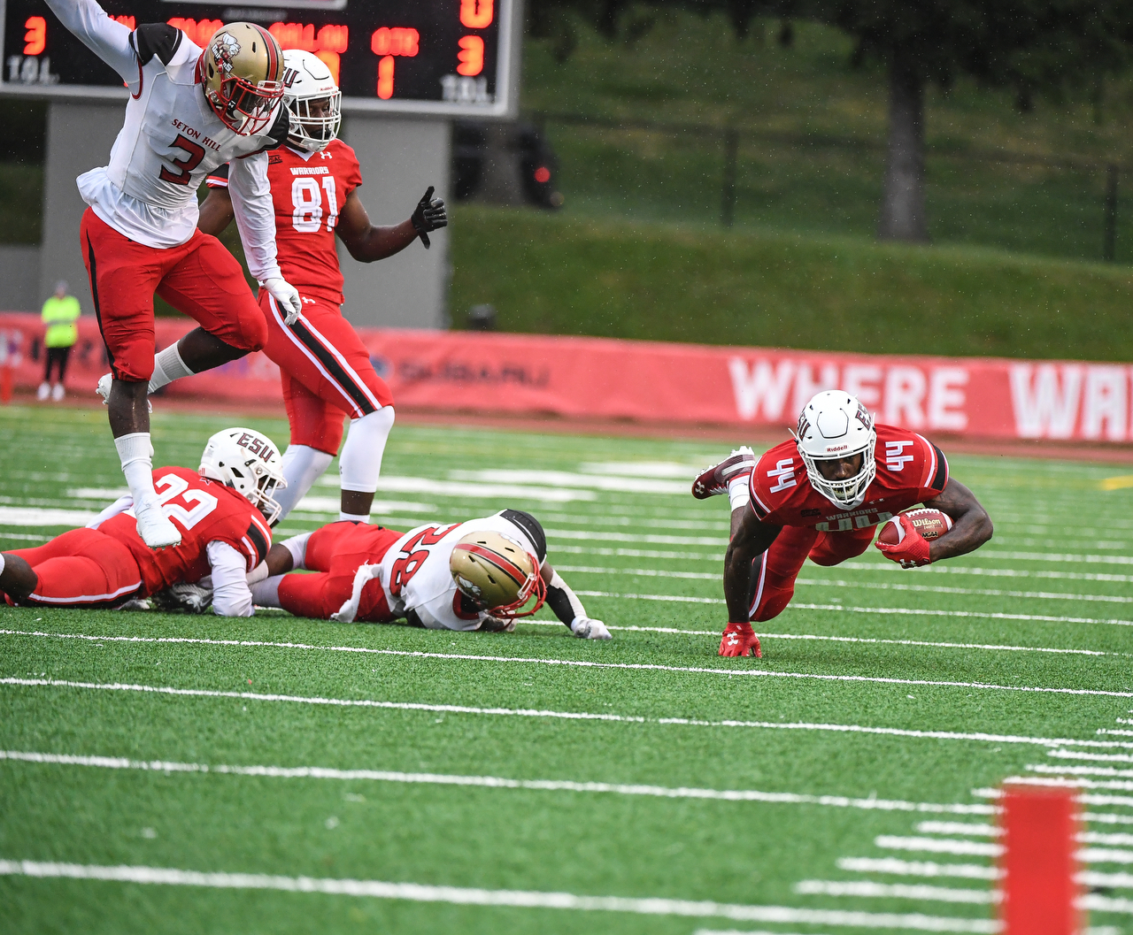 Jaymar Anderson dives for more yards against Seton Hill on Saturday night.