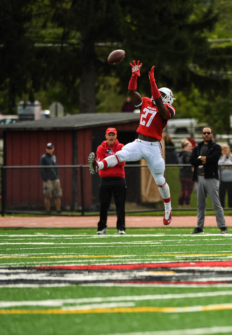 Devante Robinson catches a pass early in the first quarter against Lock Haven University on Saturday,